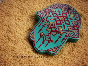 Hand painted turquoise hamsa in geometric designs from Our Folk Life.
